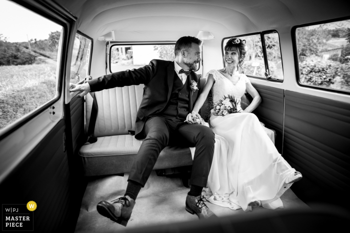 Occitanie wedding image of the bride and groom in a VW van as it was rolling on the turn road, hard to stay straight