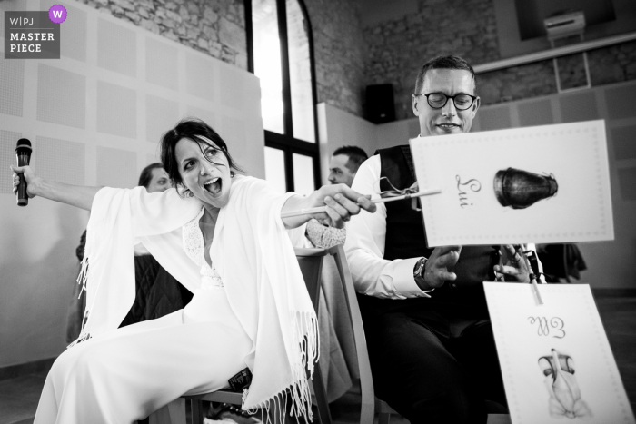 Image captured of a fun game at the French reception venue made the bride a bit unhappy with the rules