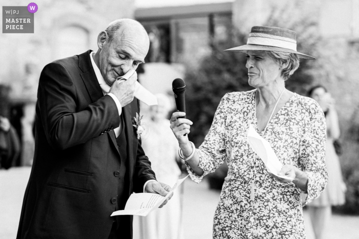 French wedding image of the father of the bride showing emotion during his speech