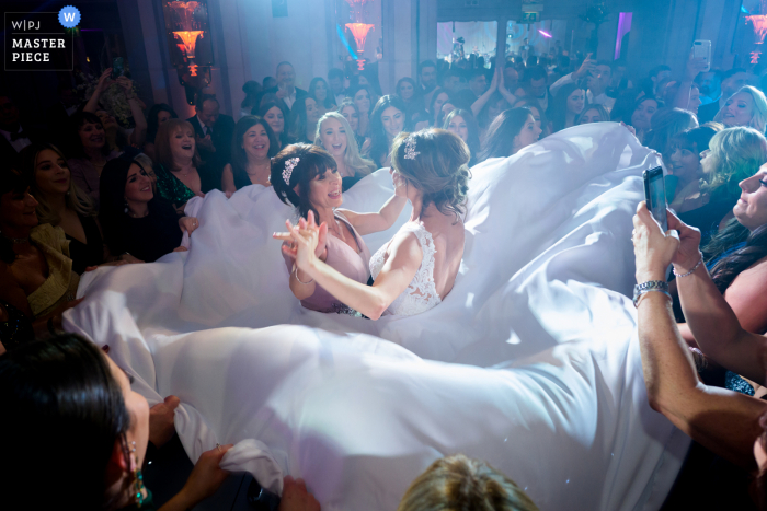 Israeli Dancing with the bride and mother of the bride at the Grosvenor House Hotel reception party