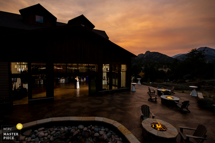 Colorado wedding photos from Black Canyon Inn at Estes Park, CO of the bride and groom first dance at sunset