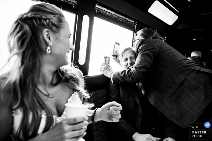 CO wedding photography on the way to Della Terra Mountain Chateau, Estes Park with a funny moment in limo with wedding party
