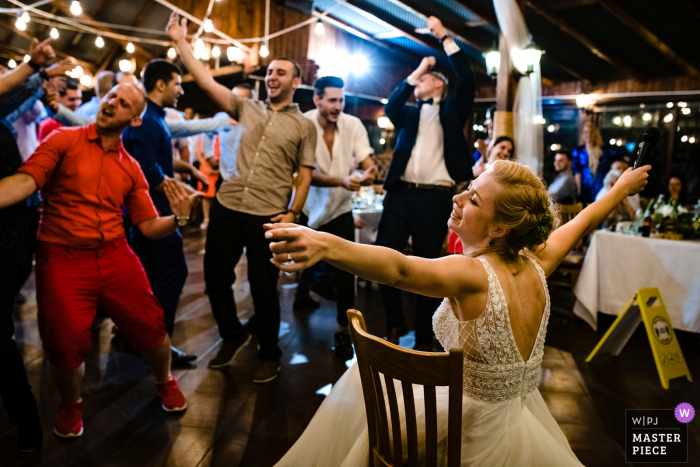 Wedding photography from the Augusta restaurant, Montana, Bulgaria showing the bride having fun at her Party