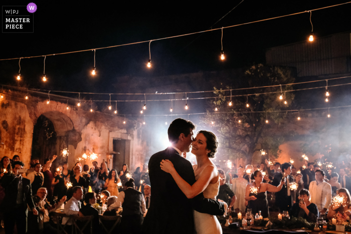 Oaxaca wedding photographer created this image from Proyecto Murguia, Oaxaca City during the First dance surrounded by their family and friends