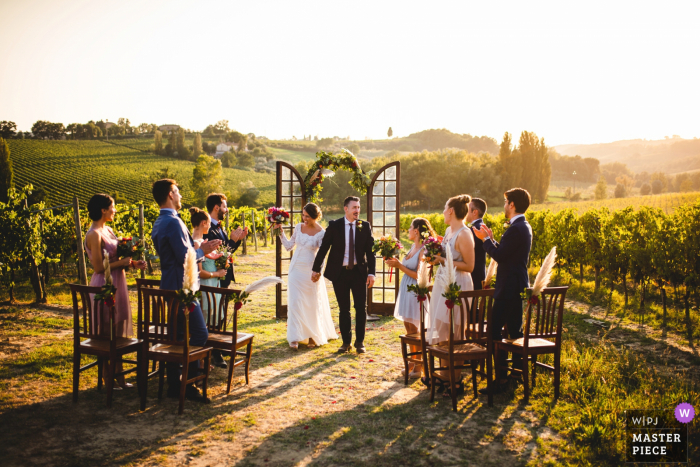 Arezzo wedding photographer shot this image at Relais Borgo Ortaglia, Tuscany during an Wedding outdoor ceremony in the vineyards