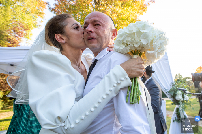 A Hautes-Pyrenees wedding photo at an Occitanie Ceremony of the Bride and her brother during ceremony