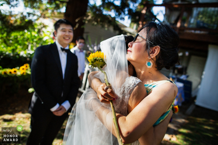 California outdoor ceremony wedding photography from Oakland showing it's Hard for Mom to let go of the bride
