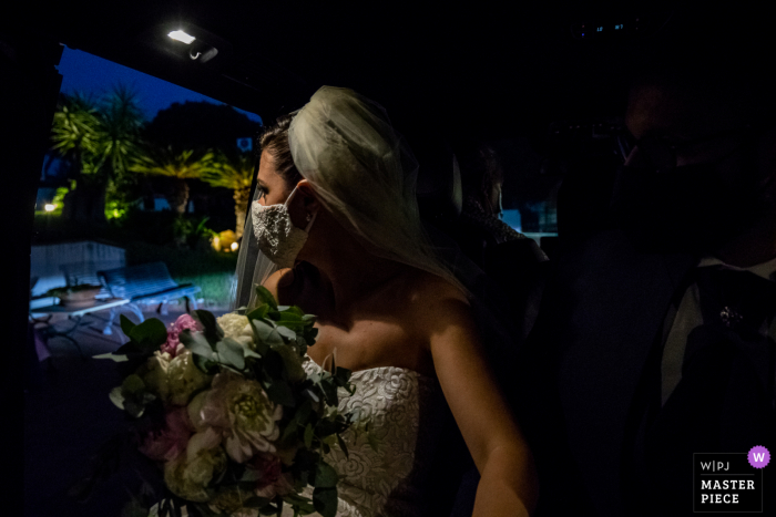 A Catania wedding photographer captured this Grand Hotel Baia Verde - Aci Castello bride looking out, and tries to figure out what her wedding will look like with the anticovid measures