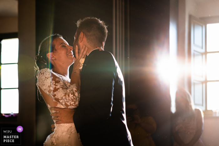 A Trieste wedding photographer captured this moment at Stanjel Castle, Slovenia of the tender First dance