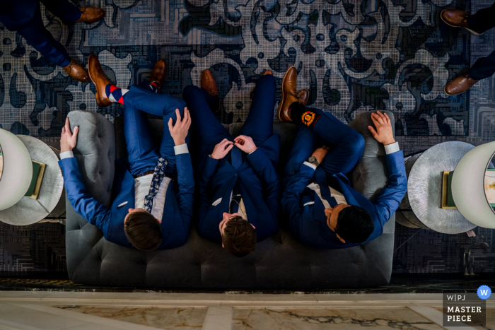 Maryland wedding photography from Hotel Monaco, Baltimore MD of The groom and groomsmen sitting in the lobby, top down view