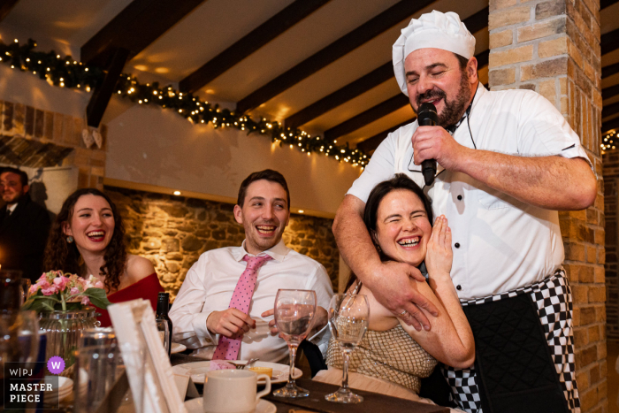 Ireland wedding photography from Segrave Barns Ireland of the The singing chef during the reception venue party