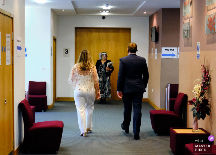 West Midlands wedding photographer created this image at the Birmingham Register Office of the Registrar waiting for bride and groom before their covid secure wedding ceremony