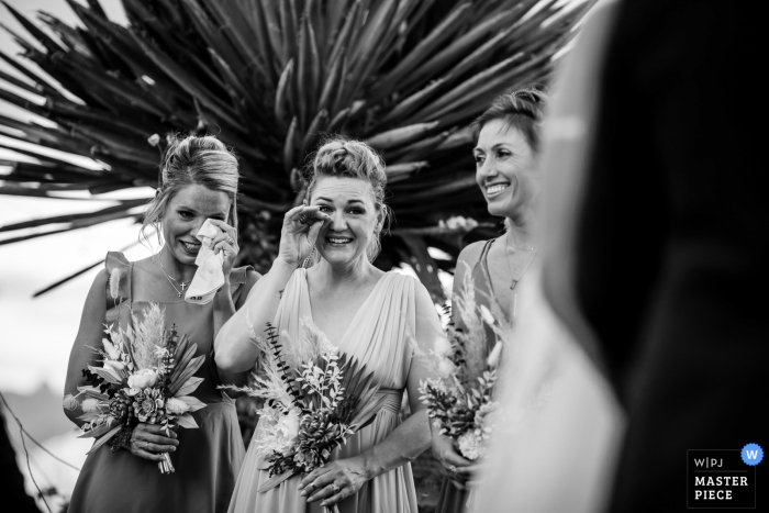 Texas wedding photo from Terlingua showing The wedding party reacting to the couples' vows.