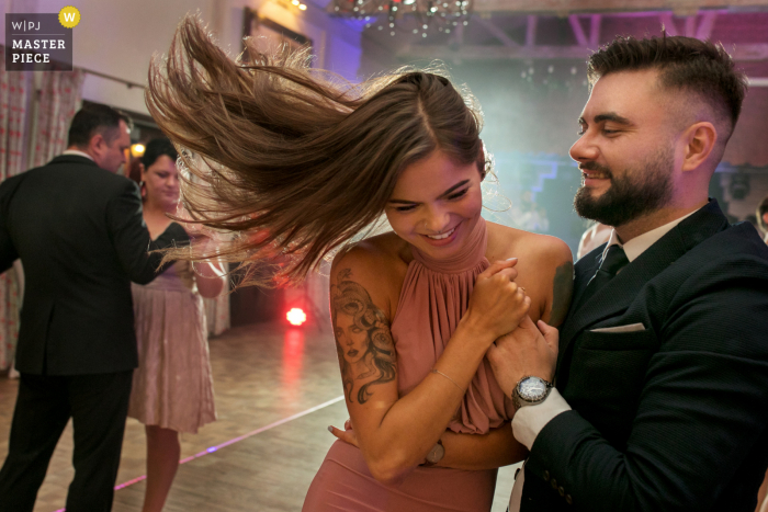 Krakow wedding photography from the Malopolskie Reception Venue	of a guest dancing with her hair in the air