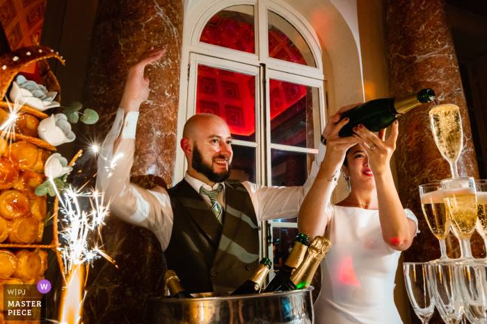 Paris wedding photography from the Île-de-France Reception venue of the bride and groom with champagne