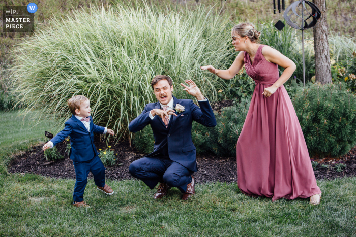 Wedding photography from a Private Residence in Omaha, Nebraska Ceremony Location of the Aunt and Uncle playing Spiderman with the ring bearer