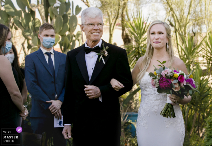 Arizona outdoor wedding photo from Hacienda del Sol Resort- Tucson, AZ showing the bride walks down the garden aisle with her father