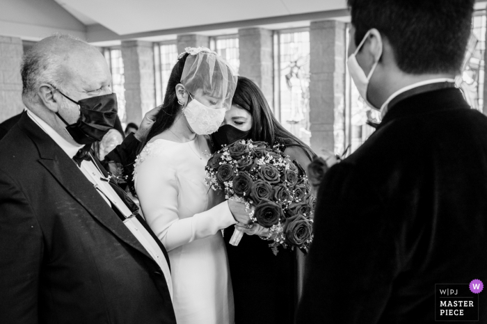 College Station, TXwedding picture showing Mom and Dad having an emotional moment before giving her daughter away during a Church Ceremony