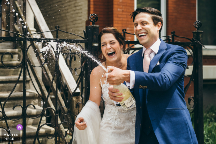 Chicago wedding photo from their Illinois Home of the couple Celebrating with Champagne