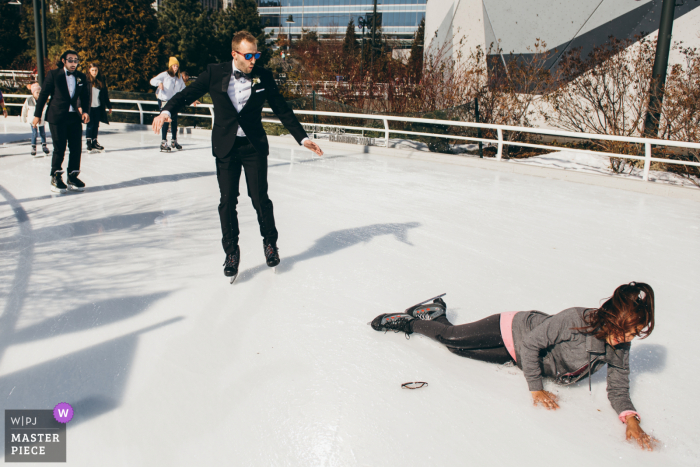 Winter Illinois wedding photo from Maggie Daley Park, Chicago of the Groom ice skating before the ceremony
