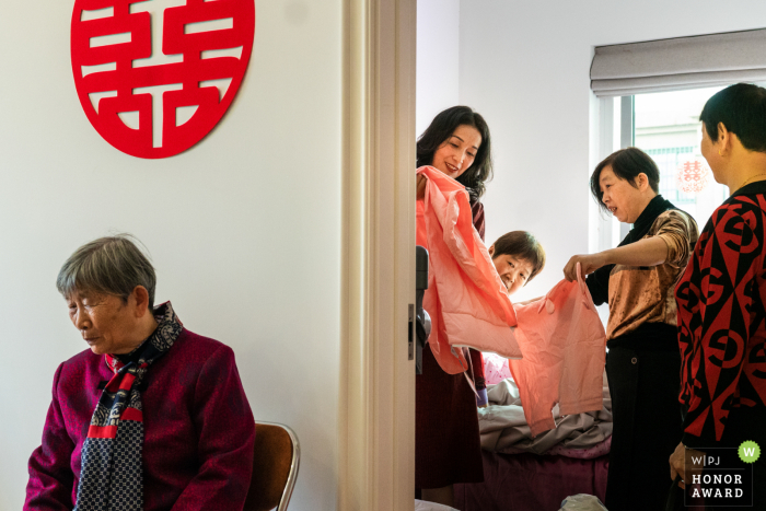 Chinese family home wedding photo of the bride getting ready for the ceremony