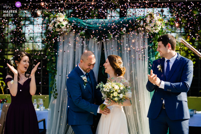 Sofia outdoor wedding photography showing Confetti during the ceremony at Koriata Restaurant, Bulgaria