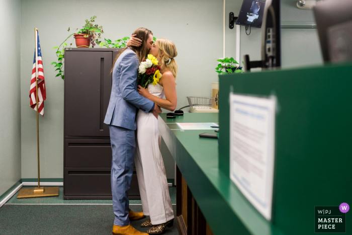 Image of the bride and groom sharing their first kiss in the County Clerk's office after their civil ceremony in South Lake Tahoe, CA