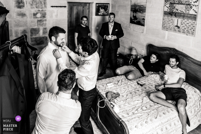 Wedding photo from Domaine du Petit Mylord showing the groom's wedding preparations