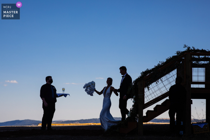 Montana wedding photo from Big Sky, MT as the couple grabs champagne after exiting chairlift