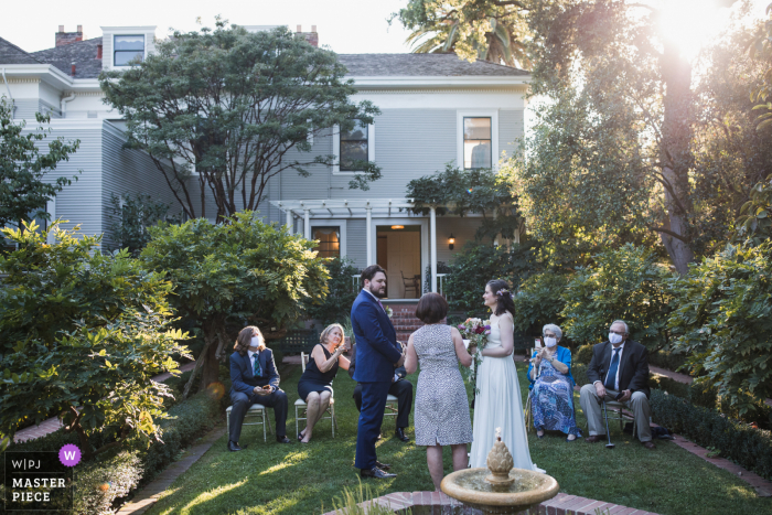 Wedding photo from The ceremony site at the Gamble Gardens in Palo Alto, California with the gorgeous light streaming through the trees gives a feeling of hope and perseverance