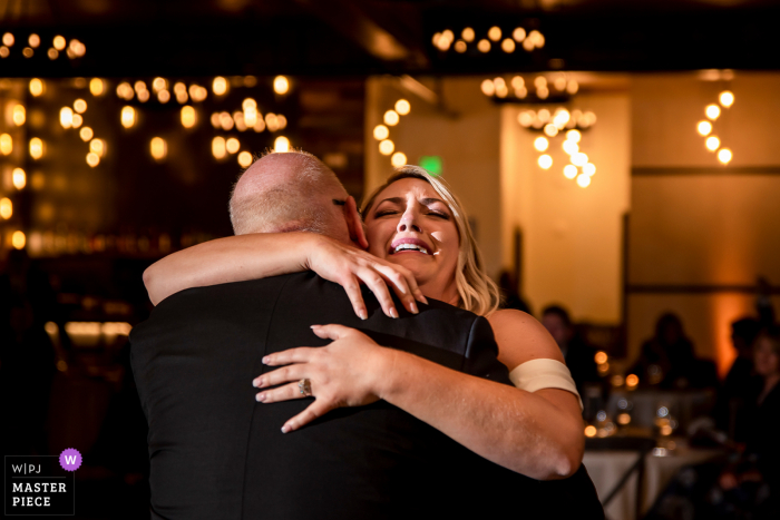 Colorado emotional wedding photo from Black Canyon Inn (Estes Park, CO) showing the bride crying during father daughter dance