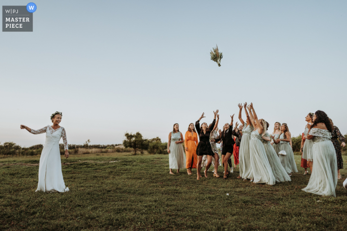 France wedding photography from the Greenhouses on the Ile de Ré of the toss of the bouquet