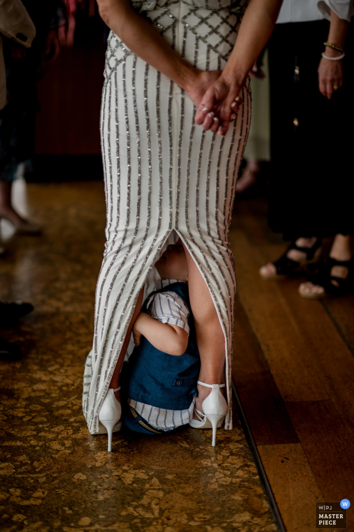 Australia wedding photograph from Baths, Middle Brighton, Melbourne of Kids being Kids under the dress of mom