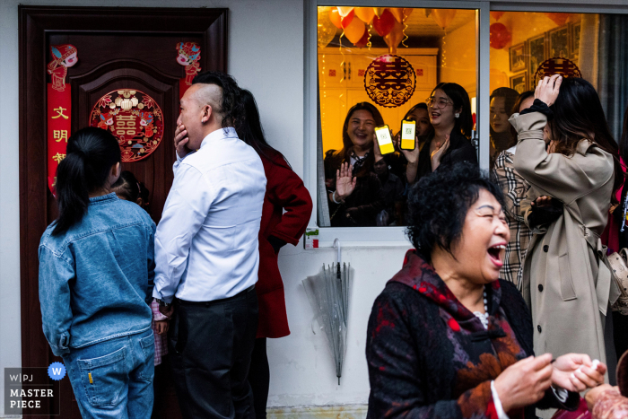 China actual wedding photo from Sichuan at The bride's home - This is the bride's room. If the groom wants to enter the room and see the bride, the groom needs to scan the QR code of the mobile phone in the window, and pay the bride's sister some money