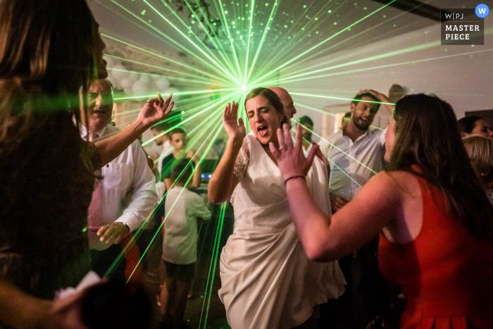 Reception venue wedding photo from La Pépinière, Châtenay-sur-Seine, France showing The Bride is dancing like crazy