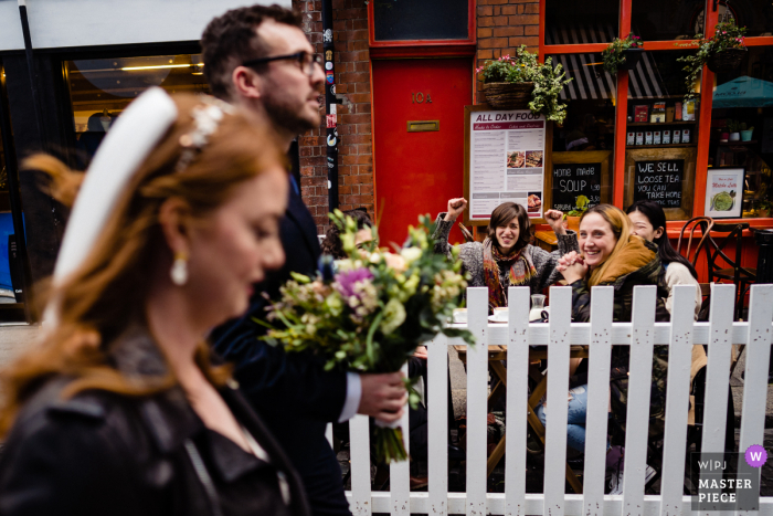 Dublin City Centre Wedding photography of the street cafe Crowd cheering couple