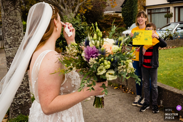 Wedding photo from Dublin of the Bride crying with neighbors