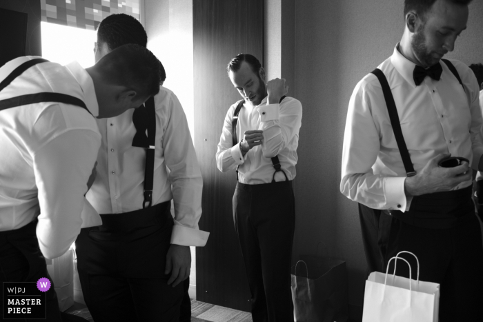 Wedding photography from Boston, MA of the groom and company getting dressed