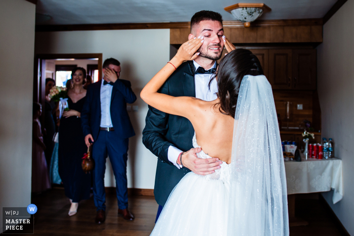 Wedding photo from Aglika Palace, Zhrebchevo, Bulgaria of the Groom crying tears of happiness to see the Bride