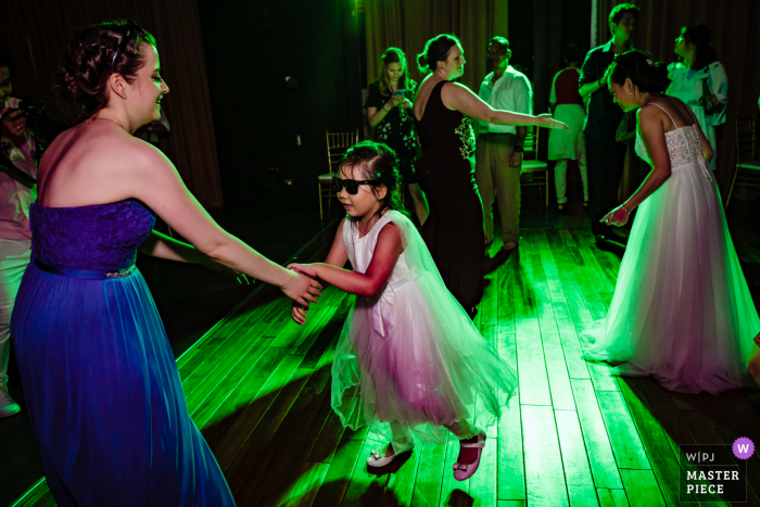 Wedding photography from Vietnam - little girl dancing at reception
