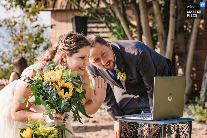 Wedding photo from California - Bride and groom greet their guests on Zoom after the ceremony