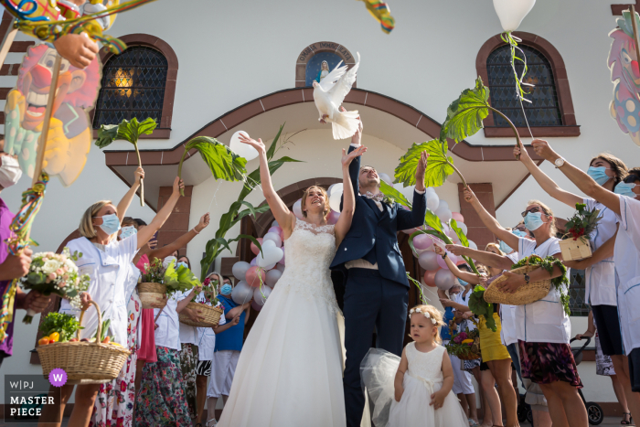 Wedding photo of the dove release at the Bas-Rhin Church	near the end of ceremony