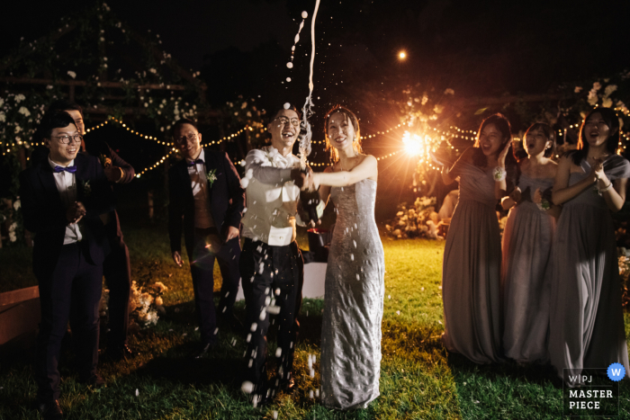 Wedding photo from Hangzhou, China. Hotel - The bride and groom spray champagne at the afterparty