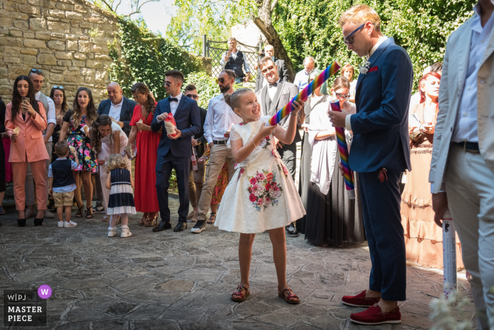 Ancona wedding photography from Chiesa di Sant'Elena of a kid with a confetti cannon without a Boom