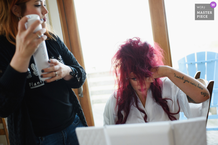 North Carolina wedding photography from South Nags Head highlighting Wild teased purple hair and a large can of hairspray