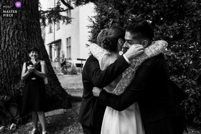 B&W wedding photo from the Ceremony location in Chateau de Morey following Bridesmaids speech and hug