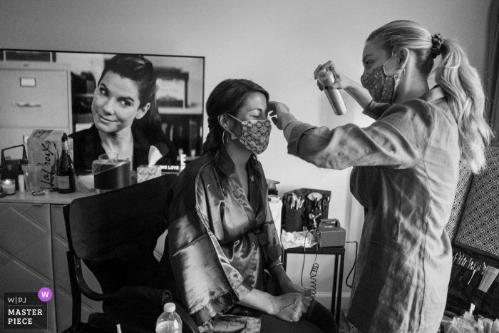California wedding photography from A private home in Burbank of The bride getting her hair and makeup done