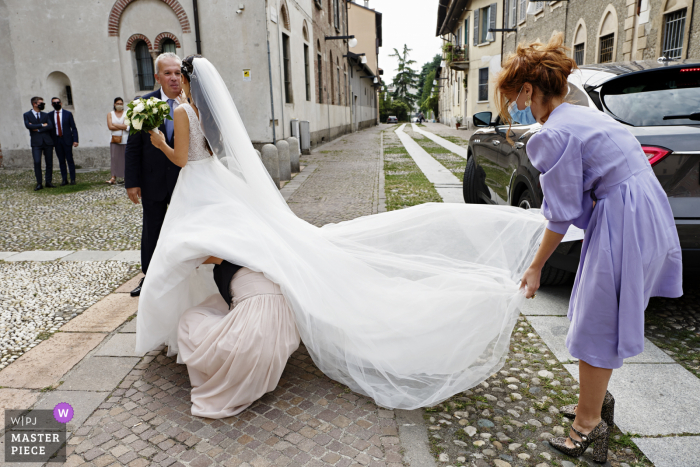 IT wedding photography from the Church of Santa Maria Rossa, Milan - ITALY taken Just before entering the church