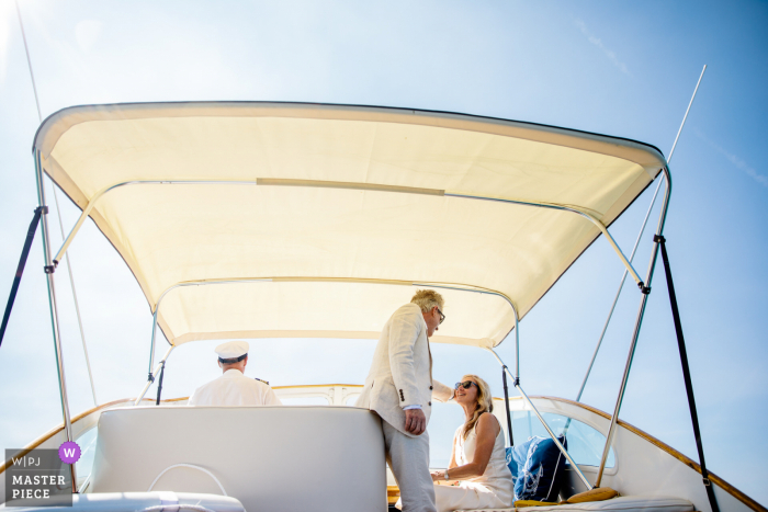 Lake Tahoe wedding image of the groom touching his bride's face before their ceremony on a boat