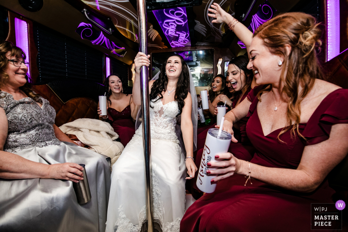Illinois wedding photo of the bride and bridesmaids in the party bus
